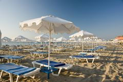 Beach umbrellas and loungers Stock Photos
