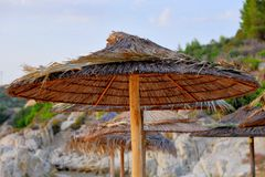 Beach umbrellas made of bamboo, on a island in Greece royalty free stock photos