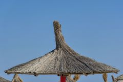 Beach umbrellas made of reeds Royalty Free Stock Images