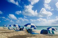 Beach umbrellas at morning Miami beach Royalty Free Stock Photography