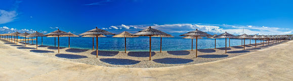 Beach umbrellas panoramic view, Vir island Royalty Free Stock Images