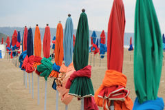 Beach umbrellas were planted on a beach (France) Royalty Free Stock Image