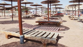 Beach umbrellas in Red Sea. Many Parasols on the beach of the Red Sea stock footage
