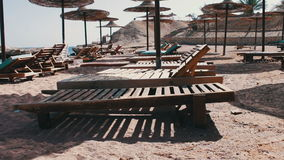Beach umbrellas in Red Sea. Many Parasols and beach mattresses on the empty beach of the Red Sea stock video footage