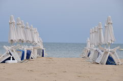 Beach umbrellas in rows Royalty Free Stock Photo