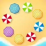 Beach umbrellas on sand at the beach, frame Stock Photography