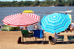 Beach umbrellas on sandy coast Royalty Free Stock Photography