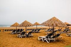 Beach umbrellas on the sandy beach. By the sea Royalty Free Stock Image