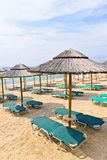 Beach umbrellas on sandy seashore Royalty Free Stock Photo