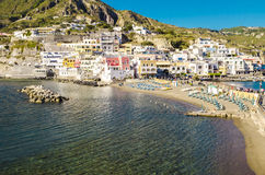 Beach with umbrellas at Sant Angelo on island Ischia, Italy Stock Images
