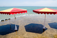 Beach umbrellas on a sea beach in Crimea Royalty Free Stock Images