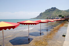 Beach umbrellas on a sea beach in Crimea Stock Photography