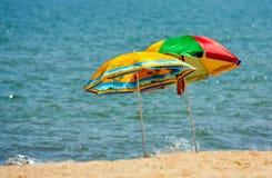 Beach umbrellas on sea Royalty Free Stock Photo
