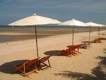 Beach umbrellas at seashore Royalty Free Stock Images