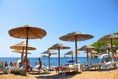 Beach umbrellas at the shore of the Adriatic. In Montenegro Royalty Free Stock Photo