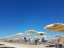 Beach umbrellas at the beach. Umbrellas on the summer sandy beach in the sun Stock Photography