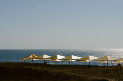 Beach. Umbrellas in the sun Stock Photo