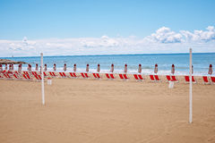 A beach with umbrellas and sun beds on coast Royalty Free Stock Photography