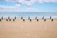 A beach with umbrellas and sun beds on coast Stock Photo