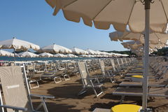 Beach umbrellas and sun beds Stock Photography