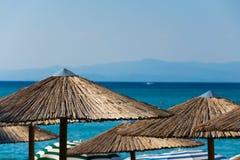 Beach umbrellas. Sun umbrella on the beach of turquoise blue sea stock image