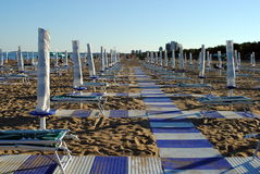 Beach umbrellas and sunbed Royalty Free Stock Image