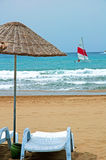 Beach umbrellas and sunbeds Stock Images