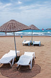 Beach umbrellas and sunbeds Royalty Free Stock Images