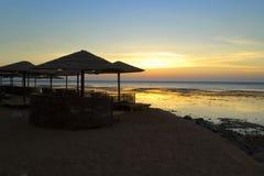 Beach umbrellas and sunbeds on the beach. Morning seascape Stock Photo