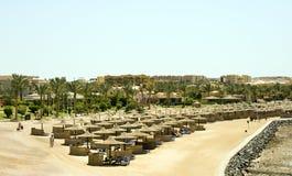 Beach umbrellas and sunbeds in Egypt. Red Sea beach - Marsa al Alam Stock Image