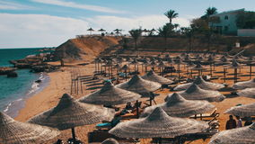 Beach Umbrellas and Sunbeds in Egypt on the Red Sea. EGYPT, SOUTH SINAI, SHARM EL SHEIKH, DECEMBER 3, 2016: Beach umbrellas and sunbeds in Egypt on the Red Sea stock video