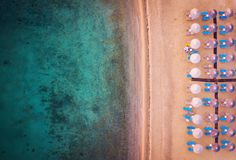 Beach with umbrellas and sunbeds aerial view. Beach with umbrellas and sunbeds making a pattern aerial view stock photography