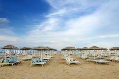Beach with umbrellas and sunbeds Stock Photos