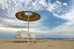 Beach with umbrellas and sunbeds Stock Images