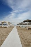 Beach with umbrellas and sunbeds Royalty Free Stock Image