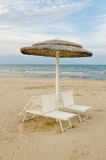 Beach with umbrellas and sunbeds Stock Photo