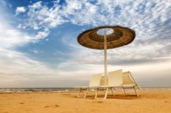 Beach with umbrellas and sunbeds Stock Photography