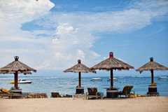 Beach umbrellas. And sunbeds with sea views royalty free stock photos