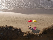 Beach umbrellas on a sunny day Stock Image