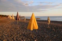 Beach umbrellas at sunset royalty free stock photos