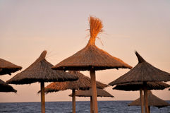 Beach umbrellas at sunset Royalty Free Stock Photography