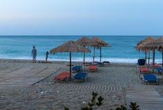 Beach Umbrellas in sunset. Beach Umbrellas, sunset in Pelion, Greece Stock Photo