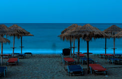 Beach Umbrellas in sunset. Beach Umbrellas, sunset in Pelion, Greece Stock Images