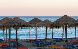 Beach Umbrellas in sunset. Beach Umbrellas, sunset in Pelion, Greece Royalty Free Stock Image