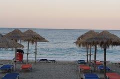 Beach Umbrellas in sunset. Beach Umbrellas, sunset in Pelion, Greece Royalty Free Stock Images