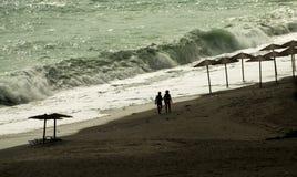 Beach Umbrellas in sunset. Beach Umbrellas, sunset in Pelion, Greece Royalty Free Stock Photo