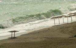 Beach Umbrellas in sunset. Beach Umbrellas, sunset in Pelion, Greece Royalty Free Stock Photos