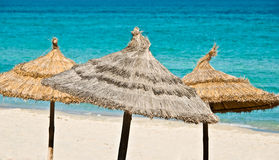 Beach umbrellas, turquoise sea Stock Photography