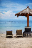 Beach umbrellas. Beach umbrella sunbeds with sea views Stock Photos
