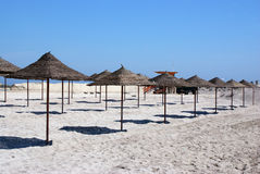 Beach umbrellas waiting tourists Royalty Free Stock Image